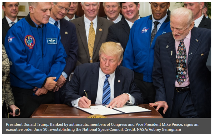 Trump sign executive order reestablishing the National Space Council.